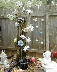 Tea Tree...Make Your Own Alice In Wonderland Garden Spot Shopping list: Old tree stump or fake tree to hide the pump and tubes. Solar pump. reservoir of water and Tea pots.