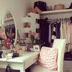 Great use of a small space. Take the closet doors off, and you're half way there! Add shelving - it's probably IKEA - and a cute vanity & chair, and you're all set! :)