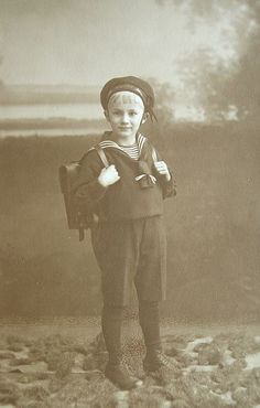 Boy in sailor suit, first day at school, 1923