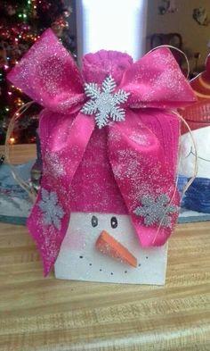 Wooden snowmen wife made