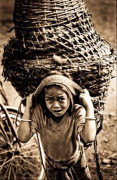 Nepali girl carrying a wicker basket
