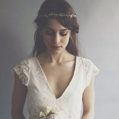 """Susannah Bridal Gown by ThisModernLoveBridal. """"A classic ivory bridal gown made with soft ivory guipiere lace, a v-neckline, little cap sleeves, a long A-line skirt and a puddle train. Simple and demure. A relaxed design which simply pulls on and cinches at the waist with elastic for a laid back look."""""""