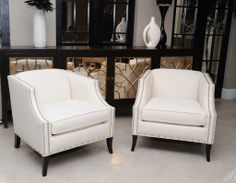 The Rory chairs sparkle with silver linen threads beside the metallic mirrored Sanctuary chest @ Sam Moore | #hpmkt2014