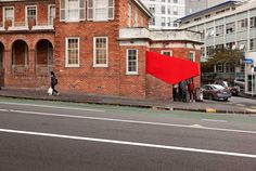 A busy Auckland street corner became the stage for an interesting installation that strives to engage the public with its urban landscape in a unique way. Architectural collective OH.NO.SUMO designed a miniature cinema to fit on to a building's staircas New Home Theatre, Home Theater Setup, Home Theater Speakers, Home Theater Projectors, Home Theater Seating, Movie Theater, Home Theater Installation, Home Theater Furniture, Home Cinemas
