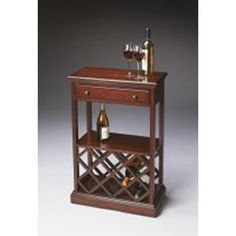Butler Plantation Cherry Finish Wine Rack 2131024. h1Butler Plantation Cherry Finish Wine Rack 2131024_h1This Butler Plantation Cherry Finish Wine Rack 2131024 features selected solid woods, wood products and choice veneers.� Cherry veneer top, drawer front and shelf. Spa.. . See More Wine Racks at http://www.ourgreatshop.com/Wine-Racks-C1118.aspx