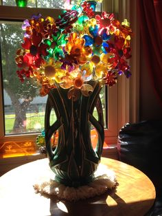 Vintage lucite flowers from the 60s and 70s in a McCoy strap vase