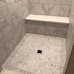 Carrara 2 x 2 Hexagon Porcelain Mosaic Tile Carrara 2 x 2 Hexagon Porcelain Mosaic Tile with Mapei Warm Gray grout. Shower Floor Tile, Bathroom Floor Tiles, Bathroom Mirrors, Bathroom Cabinets, Bathroom Fixtures, Mosaic Shower Tile, Gray Shower Tile, Bathroom Tile Installation, Bathroom Tray