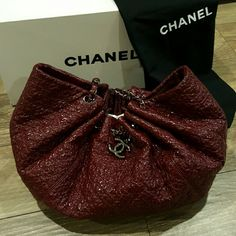 """Chanel Vinyl Embroidered Camellia Tote, Bordeaux Authentic Chanel embroidered camellia pattern grand shopping tote in bordeaux vinyl with gunmetal chain straps and dangling """"cc"""" charm. Grey satin interior with a zip pocket, 2 open pouches, and a key strap hook. Original dust bag and box included but no authenticity card. In very good condition with some wear on the straps where the vinyl has peeled off and """"suede"""" is exposed. Ask for more photos. CHANEL Bags Totes"""