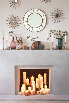 Do you have a fireplace you never actually use? Just because you don't want to deal with chopping wood and cleaning the flue doesn't mean your fireplace can't be a focal point. In the fireplace, try displaying candles of various heights. You still get rich ambiance and a warm glow but none of the headaches of dealing with fireplace maintenance.