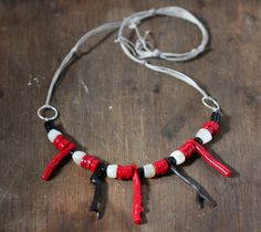 Necklace of the Deep Sea,   Red Coral,  Black Coral, Mother of Pearl Beads and Black Jasper by HammeredandFired on Etsy https://www.etsy.com/au/listing/493030218/necklace-of-the-deep-sea-red-coral-black