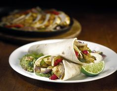 FAMOUS FAJITAS Your choice of grilled chicken, beef or shrimp, served with pico de gallo, Monterey Jack and cheddar cheese, fresh guacamole, sour cream and warm tortillas.*  Duo Combo Trio Combo Grilled Beef* Grilled Chicken* Grilled Shrimp*