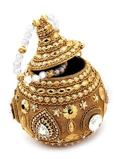 Luxurious golden color brass metal #Potli #Purse ornamented with glittering diamantes and crystals. Item Code: SJBP2012 http://www.bharatplaza.com/new-arrivals/accessories.html