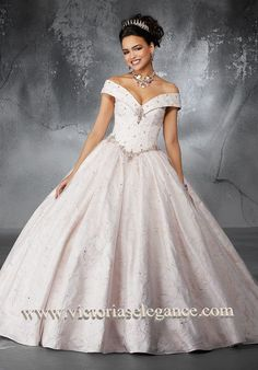 Sophisticated and elegant, this unique floral pattern brocade ballgown features an off-the-shoulder v-neckline bodice. The full skirt is accented with a tulle overlay and delicate beading. Matching tulle stole included. Grad Dresses, Ball Dresses, Ball Gowns, Prom Dress, Pageant Dresses, Dress Formal, Sweet 15 Dresses, Sweet Dress, Pretty Dresses