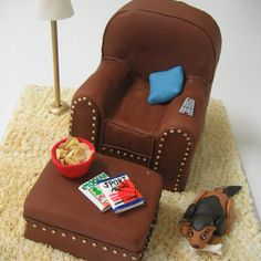 Grooms Gone Wild! Easy Chair  The Bakers: Classic Cakes, Carmel, IN  The Challenge: Make the groom feel right at home.  Fun Fact: All the must-have relaxing accessories — magazines, chips, and remote control — were crafted out of fondant.
