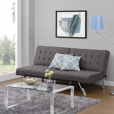 Classic comfort, style and function all rolled into one in this convertible futon sofa from DHP.
