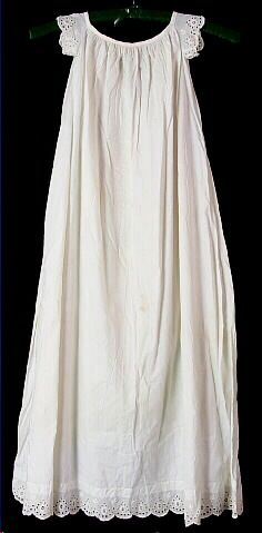 Dress, baby's, off-white cotton, long waistless sack with wide eyelet trim, 1850-1859