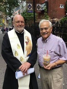 Paulist Fr. John Collins chatting with a friend in front of Manhattan's Holy Cross Church. (Fr. Jack is wearing the Paulist habit.) — at Holy Cross Church (New York City) on Sept 20, 2017
