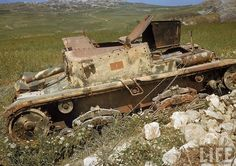 vintage everyday: Color Photos of Tunisia and Libya in the North African Campaign of World War II, 1943 Abandoned Italian tank. ( death trap)