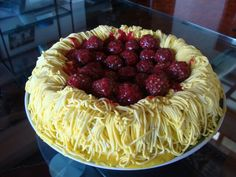 Spaghetti and Meatball Cake  Chocolate cake covered in spaghetti icing, with Ferrero Roche meatballs smothered with raspberry sauce.  Yum, anyone for italian ;-)