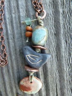 Lovely bird from Slate Studios, with ceramic from Gaea and enameled copper from Artisan Beads Plus