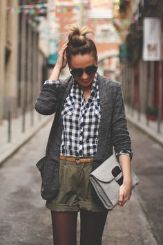 High waisted shorts,button down shirt, with orange belt, grey cardigan,grey clutch,and tights under the shorts