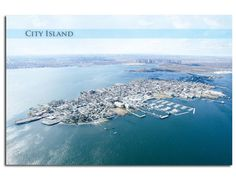 City Island Postcard    City Island is a 1.5 by 0.5 mile island east of the Bronx mainland. It has long been a center of maritime life in New York City and continues to be a vibrant nautical community, with yacht clubs, sailing schools, marinas, fishing and lobster boats. City Island currently has a population of approximately 5,000 people.