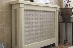 Hide an old radiator/heater with a decorative panel/screen-cover cabinet