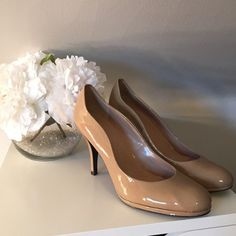 Tahari nude pumps size 8.5 These are nude patent leather pumps with a medium height heel. Worn twice, fantastic condition. Tahari Shoes Heels