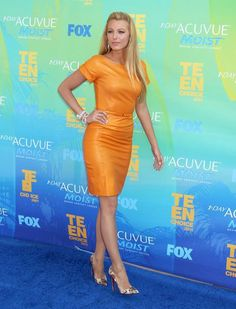 Blake Lively sizzled at the Teen's Choice Awards in an orange Gucci Resort 2012 leather mini. She teamed the dress with amazing leopard print Christian Louboutins pumps, bronze make-up and Lorraine Schwartz jewellery.
