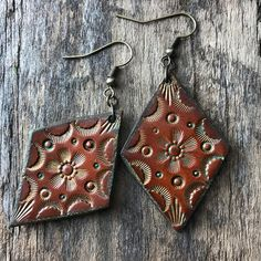 Hand Tooled Leather Earrings Diamond Shaped Leather Earrings by Red Pony Leather Goods. You can follow us on Instagram to find out who we are and how we make things.