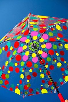 I remember these clear umbrellas from the 60's.  Colorful•°•