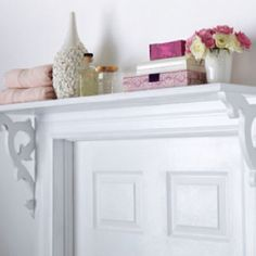 Adding shelves above doorways to decorate and create space. A place for knick knacks or stored items...out of the way of main useable surfaces.