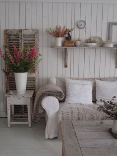 Love the use of the shutters behind the table and the shelf over the sofa.  Brings the eye upwards for balance in the room.
