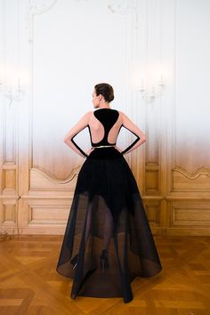 Stephane Rolland | Fall 2014 Couture | 1 Black long sleeve maxi dress with sheer hem (back)