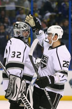 APRIL 28: Jonathan Quick #32 and Slava Voynov #26 both of the Los Angeles Kings celebrate beating the St. Louis Blues in Game One of the Western Conference Semifinals during the 2012 NHL Stanley Cup Playoffs at the Scottrade Center on April 28, 2012 in St. Louis, Missouri. (Photo by Dilip Vishwanat/Getty Images)