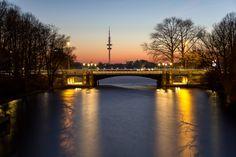 Reflecting Schwanenwik Bridge - The reflecting Schwanenwik bridge in Hamburg. Captured during the blue hour.