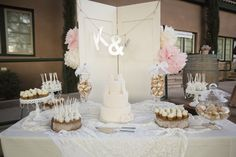 Cream, blush, and lace wedding dessert table