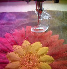 Great adornment idea - layer organza over silk flowers and machine quilt