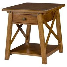 """Bring stately style to your living room or den with this industrial-chic end table, showcasing 1 drawer and 1 fixed shelf.  Product: End tableConstruction Material: Alder wood, poplar wood solids and rustic alder veneersColor: NaturalFeatures:  One drawerOne open lower shelfX-shaped accents Dimensions: 25.25"""" H x 25"""" W x 28"""" D"""