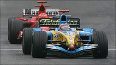 Renault's Fernando Alonso holds off Michael Schumacher's Ferrari at Imola in 2005