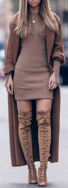 Brown sweater dress with long brown coat and long brown boots