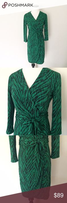 OLEG CASSINI Green reptile print faux Wrap Dress This is a truly beautiful dress. The fabric is a soft polyester. Green and black reptile print. Faux Wrap Dress has a tie around the waistband a hidden snap on chest. Size 2. OC by Oleg Cassini. Oleg Cassini Dresses