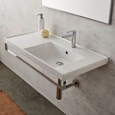 Wall Mounted White Ceramic Bathroom Sink With Polished Chrome Towel Bar Is Made