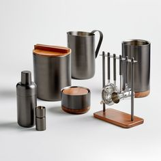 Sale ends soon. Shop Fenton Graphite and Wood Bar Tool Set. Our Fenton bar tool set translates simple lines and straightforward function into a sleek, contemporary design with mirror-finished heads and matte graphite handles. Barrel Bar, Crate And Barrel, Nickel Plating, Bar Accessories, Bar Tools, Bar Set, Tool Set, Graphite, Crates