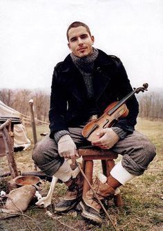 Hmm a man with an instrument.