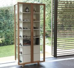 The Vitrina Tall Cabinet is a striking piece for displaying and storing a whole range of items in.