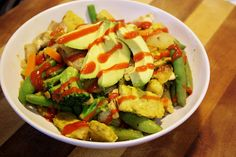steamed vegetable recipe [from this rawsome vegan life]    lightly saute 3 cups of carrots, beans, broccoli, corn and mushrooms with salt, pepper and spices. Add some soy sauce, seasoned tempeh, sliced avocado and Sriracha