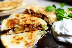 Grilled chicken & pineapple quesadillas - grill extra chicken and pineapple and then store in fridge for quesadillas later.