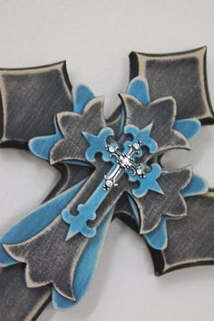 Turquoise and black wall cross