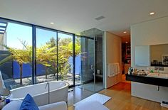 The spacious master bath even includes a view of the outdoors.  Source: Zillow